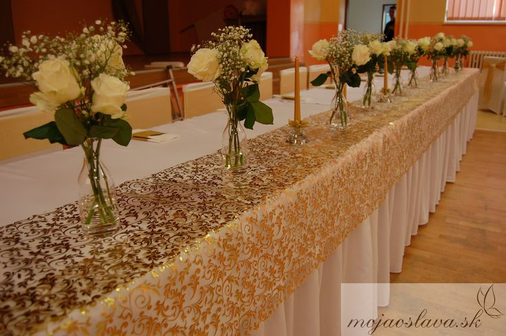 gold wedding table with white roses and gypsophila