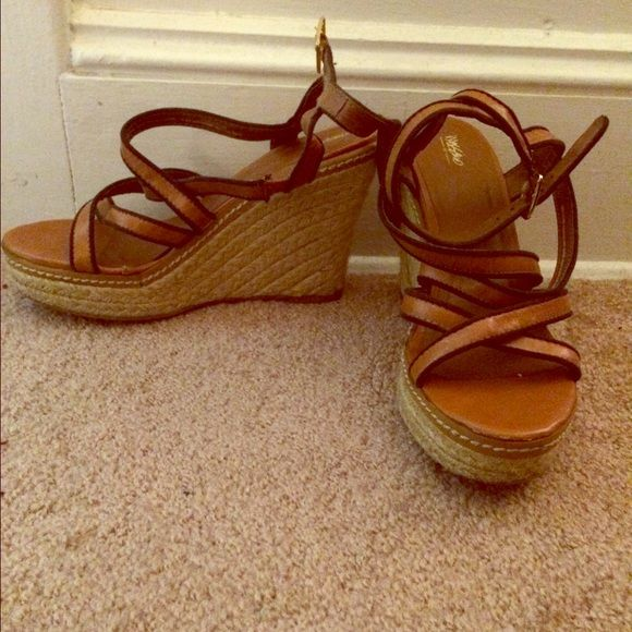 Slightly worn, tan and navy espadrilles wedge extremely comfortable height! Tan goes with everything! Add a lining of navy blue to class your outfit up a bit. And the wrap around the ankle is always a favorite! Shoes Espadrilles