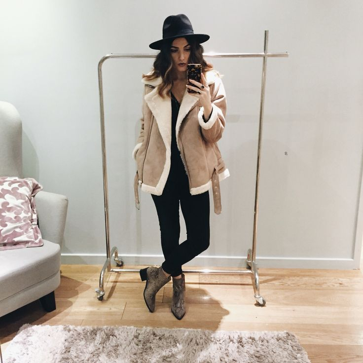 Keep your outerwear on point in shearling this season, we're loving the classic aviator biker jacket paired with black skinnies and a fedora. #Topshop