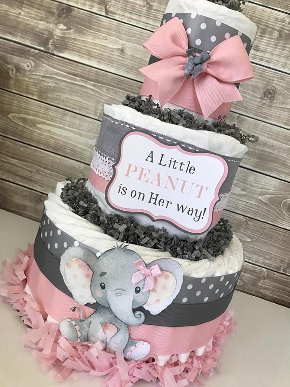 This popular Elephant design is one of our top sellers! Decorated in a pink and gray color scheme and designed using brand name diapers and high end materials this Baby Shower Centerpiece will be the talk of the party! This Themed Diaper Cake would make the perfect centerpiece for the