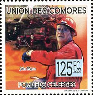 Почтовая служба Союза Коморских Островов, изображен американский артист Джон Уэйн (John Wayne) в картине «Адские бойцы» (Hellfighters), 1968, США.