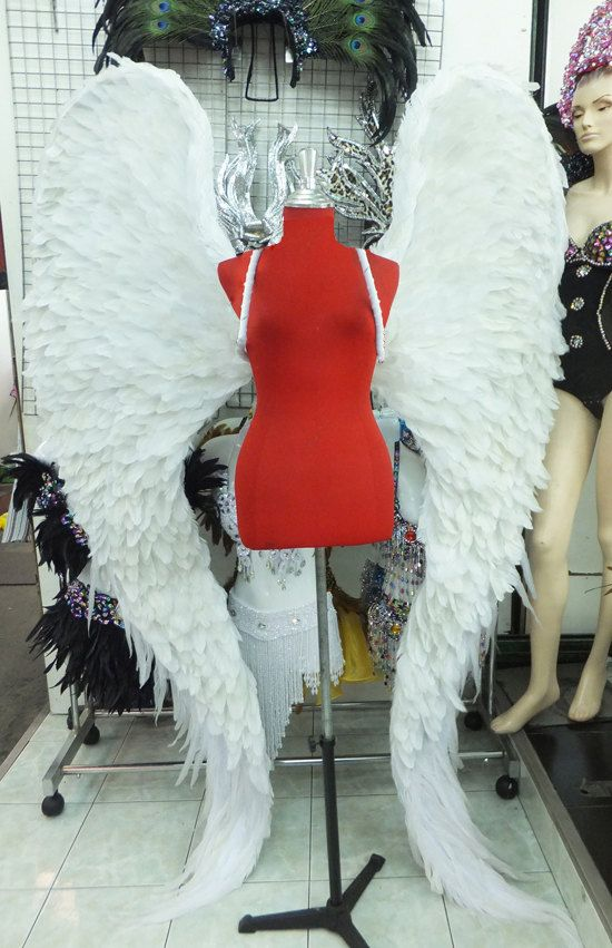 No lie, I've asked the store clerk at least 10 times if they sold their wings...Sadly they don't :(...Victoria Secret Model Angel Wings by DaNeeNa on Etsy, $499.00. If I was rich, I'd buy them.