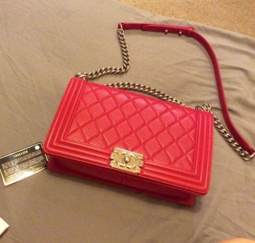 https://www.tradesy.com/bags/chanel-cross-body-bag-dark-red-1296779/?tref=closet red Chanel boy bag with shiny chain