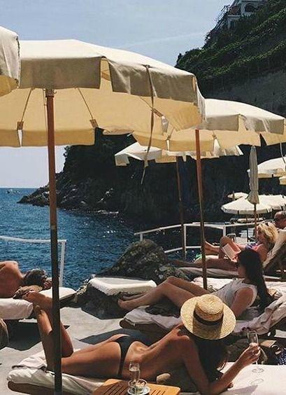 Lounging on the #amalfi with @haromarissa in her 'Nero' ROCHA Bikini Bottoms. High-quality black minimal style bikini at www.sommerswim.com @sommerswim