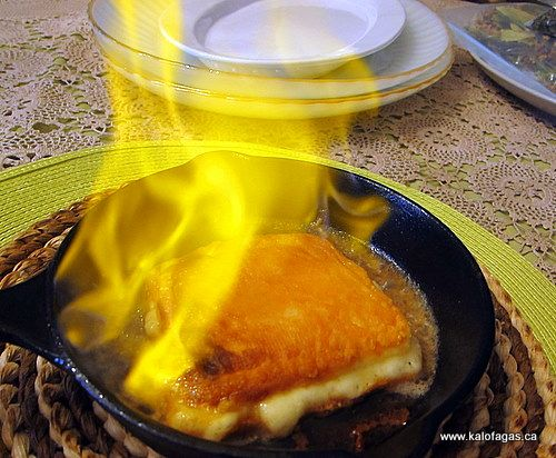 Cheese Saganaki 1 slab of cheese, 4″ x 4″ and 1/2″ inch thick 1 heaping Tbsp. of olive oil all-purpose flour for dredging 1/2 shot glass of brandy wedge of lemon.  OPA