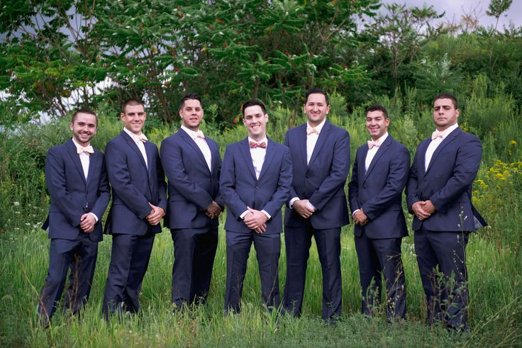 Groomsmen in Blue Calvin Klein Suits and Peach Bow Ties