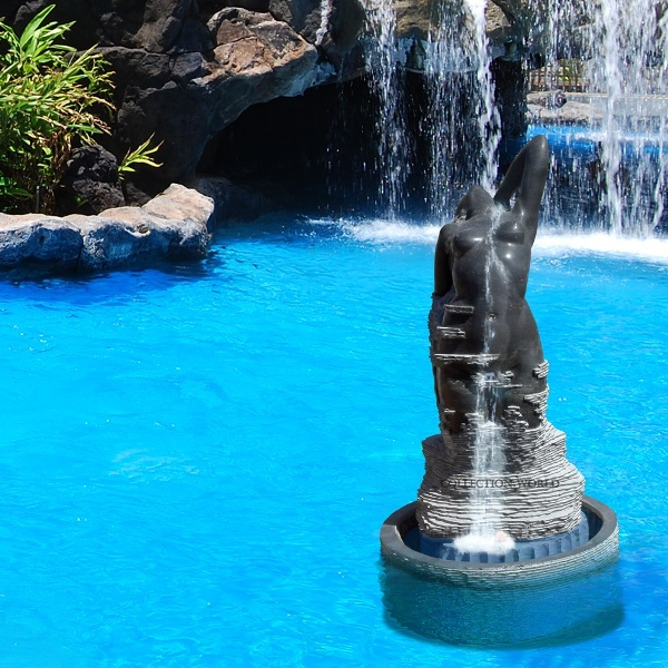 SOLD. Similar models available and can be done upon request. Modern style hand carved fountain and pool in black belgium marble. Two piece work, with the carved figure standing on a solid round pool that holds the pump. Please check the link below for profile with a photo in our premises in Marbella, Spain.