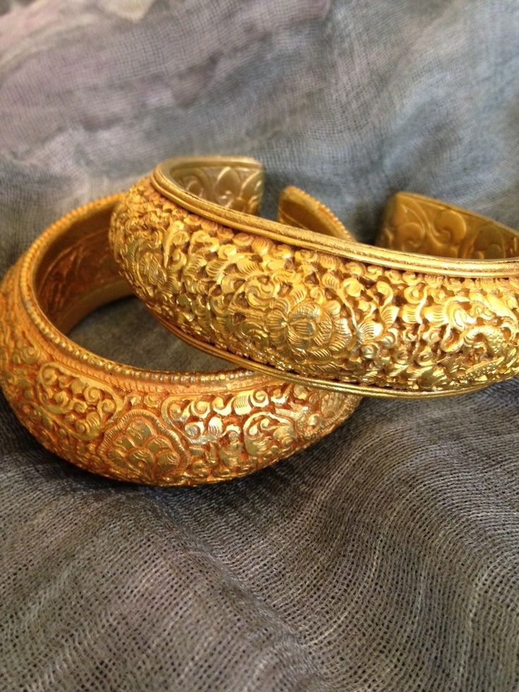 Gold kada with floral carving