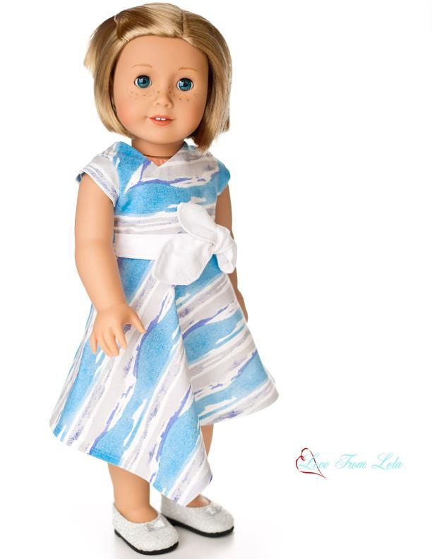 "Looking for an adorable party dress for your American Girl Doll? Make one with the Off Center Dress 18"" Doll Clothes Pattern! Find it at Pixie Faire."