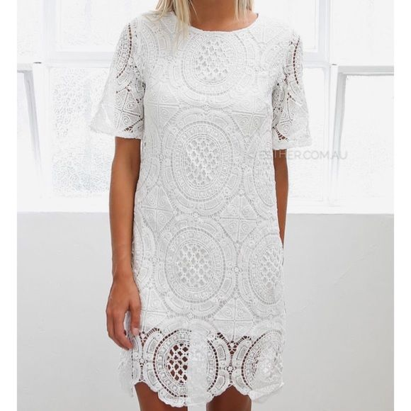 Esther Boutique White Crochet Lace Dress Gorgeous white crochet lace dress with scalloped bottom from Australian site, Esther Boutique. Size 6 (their smallest size you can buy), and fits very small. Worn a few times to work functions. Great used condition, no stains, marks. Esther Boutique  Dresses