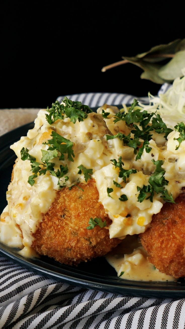 What's not to love about a hearty shrimp fritter topped with an eggy cream sauce?