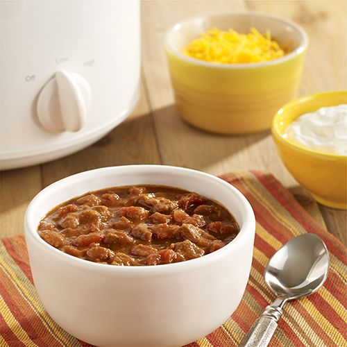 A slow cooker recipe for a flavor-packed chili with cubed beef, seasoned pinto beans and diced tomatoes with green chilies