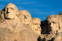 Like a magnificent mirage, four presidential faces gaze out from Mt. Rushmore — Washington, Jefferson, Teddy Roosevelt, and Lincoln. Credit for this triumph of artistry and engineering belongs to Gutzon Borglum, an Idaho-born sculptor.