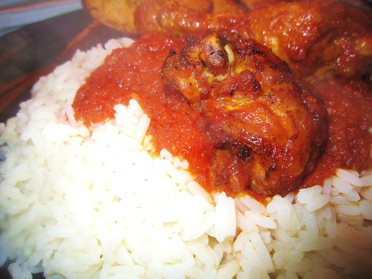 nigerian fried chicken stew with rice and plantain