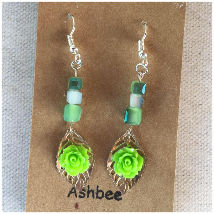 A personal favorite from my Etsy shop https://www.etsy.com/ca/listing/531350222/green-mini-resin-rose-drop-earrings