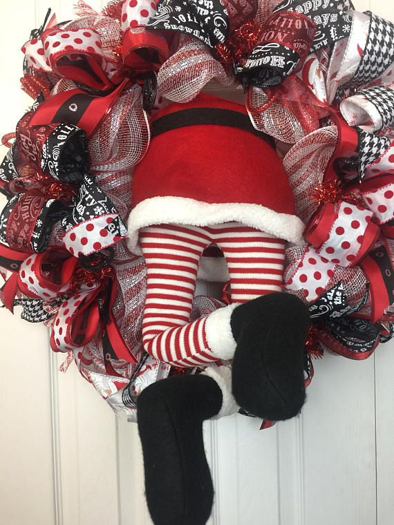 """This cute santa booty wreath is such a cute way to celebrate the Christmas season. This wreath looks like santa didn't make it down the chimney and thought the wreath would work. His legs are posable adjust them how you want. He measures 27"""" around and up to two three feet his legs are"""