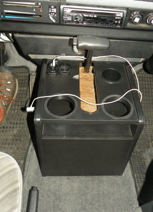 Pictured is the automatic version of the center console installed with electrical outlets and a brush in the shift gate both of which are not included. This console has...