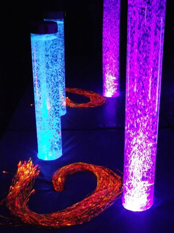 A pair of bubble tubes in a plinth with a UV fibre optic harness