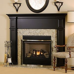Black Fireplace Mantel.  I need to find someone to make this for my corner fireplace wall.