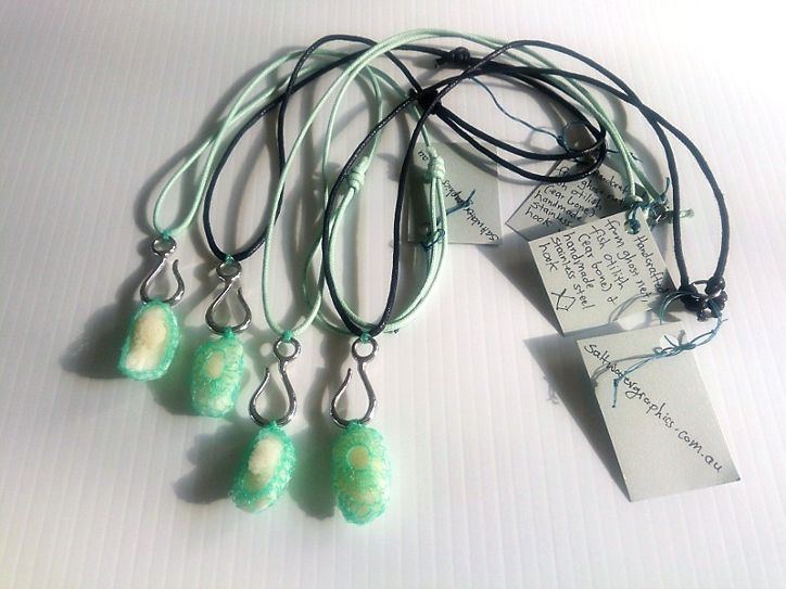 Necklaces made from ghost net, handmade stainless steel hook and fish otoliths (ear bones)
