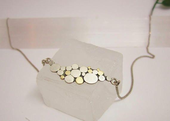 Zilveren colliertje met schijfjes goud en zilver / Ontwerp van Karen Klein edelsmid