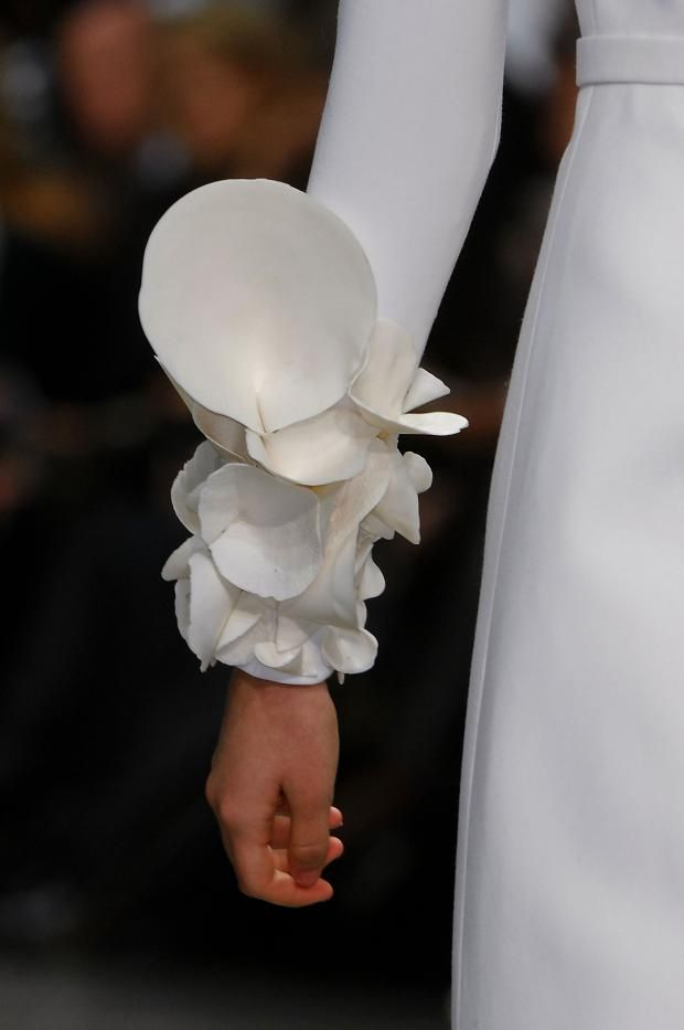 Wearable Art - sculptural sleeve adornments resembling organic form; white on white fashion; 3D surface textures // Stephane Rolland