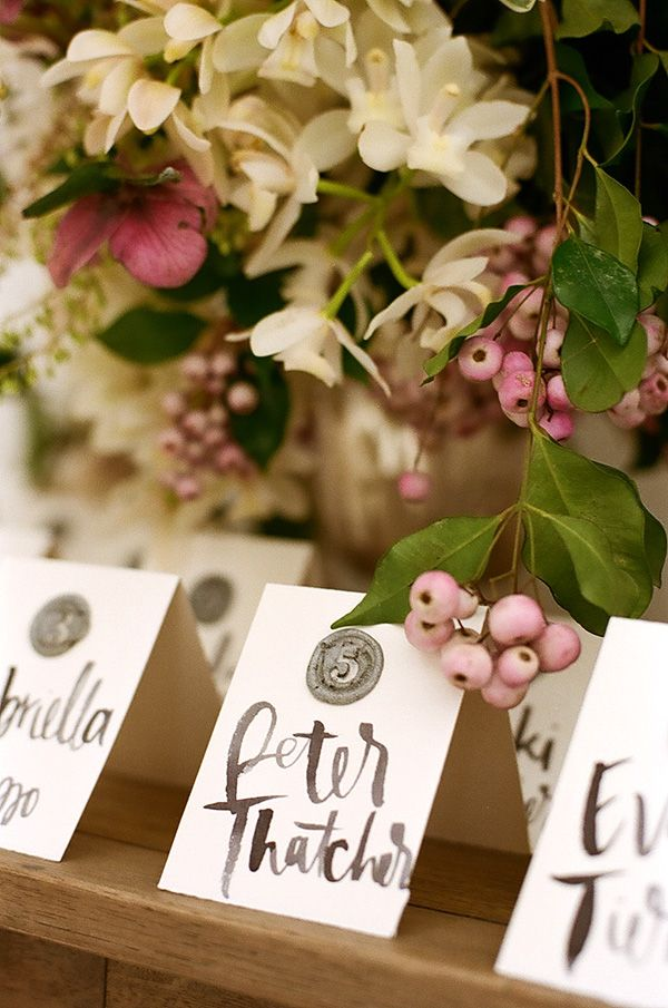 DIY wax seal escort cards from Adelphi Events.  Calligraphy by Joy+Confetti.  Photo Christina McNeill.  Flowers:  Loop Flowers.