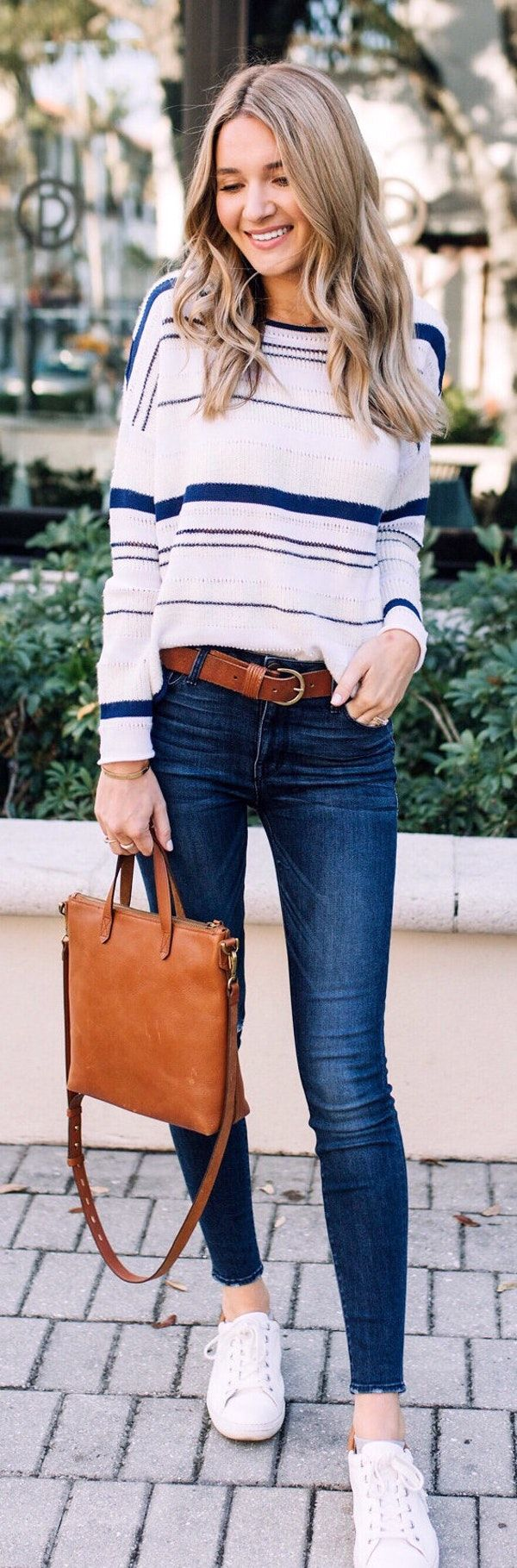 #spring #outfits  woman in white and blue striped long-sleeved shirt and blue jeans. Pic by @kaitlinkkeegan