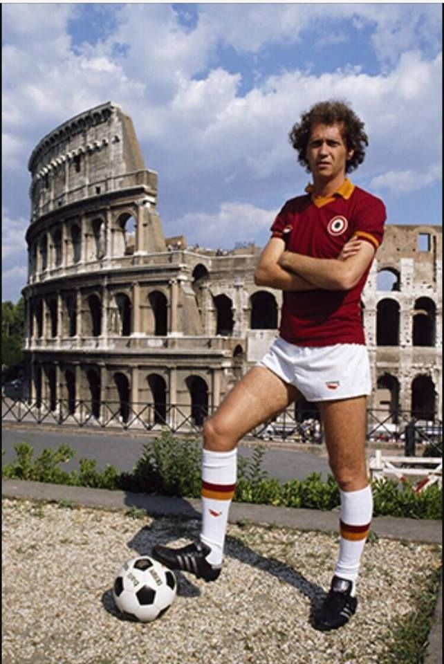 Paulo Roberto Falcao, brazilian legend, shown up in front of the Colosseum when he arrived at Rome, 1980.