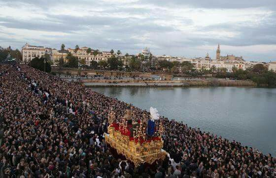 San Gonzalo Brotherhood crossing the Triana Bridge over the Guadalquivir River. One of the celebrations of the Semana Santa (Holy Week) in Seville, Spain