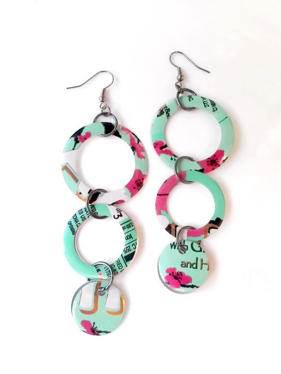 Recycled soda can jewelry.    These fun earrings were created from recycled Arizona Tea aluminum cans! The circles are very light weight and will get tons of compliments. For those who like a fun generous long length. A great eco friendly gift too!    Earrings hang 3 5/8.  Largest circle measures 1 3/8. (two circles hang back to back to make them double sided)    All recycled cans are washed, sanitized and edges filed to prevent sharp edges.    Shop our store online and find more fu...
