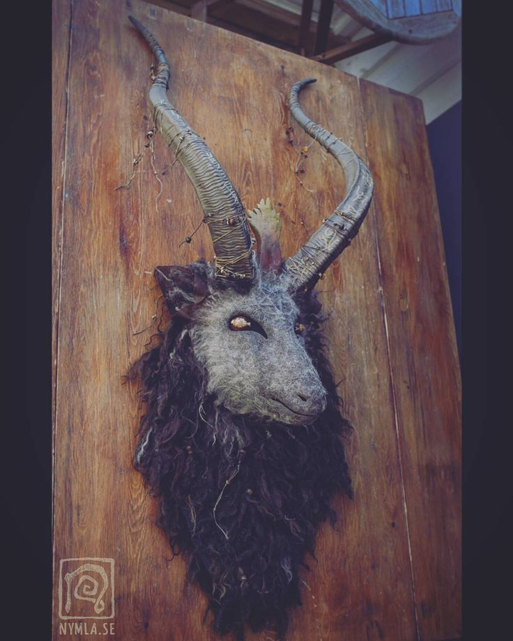 "I'm going to quote April Ludgate: ""Dark Lord RIIISE in Hell... fire..."" (Parks and rec good series ) I'd like one of these on my living room wall myself actually hmm.  This Baphomet mask is made of my own paper clay sheeps wool fabrics leather ears shell eyes etc. The flame of intelligence and the horns are cast in resin. Sigils are carved into the horns and there is a subtle pentagram on the forhead. (Sold) #nymla #masks"