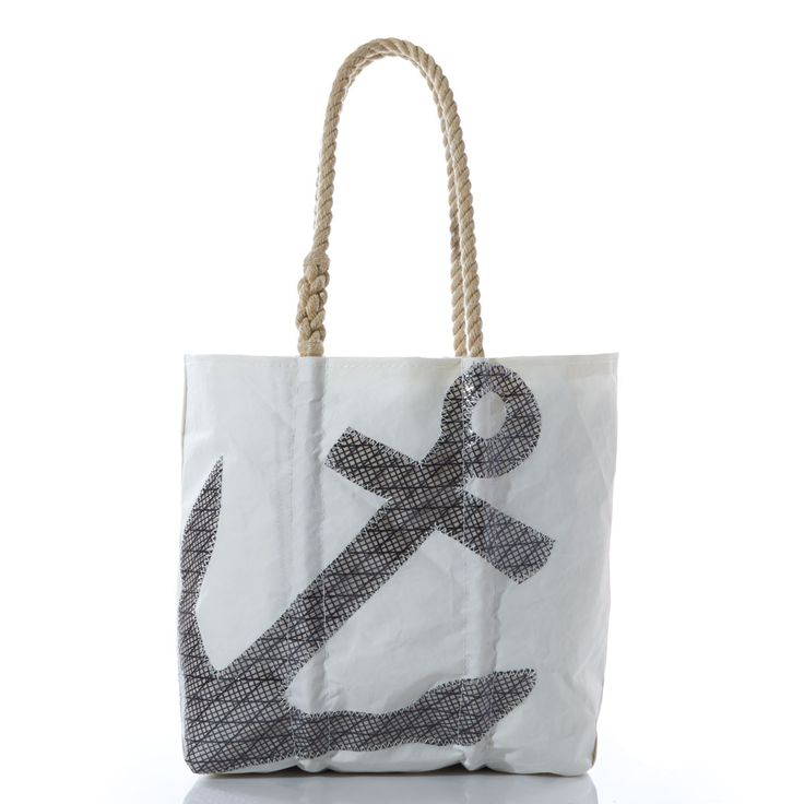 Beautiful handmade tote bags made from repurposed sails. Got to love that rope handle detail. Very clever Sea Bags Maine.