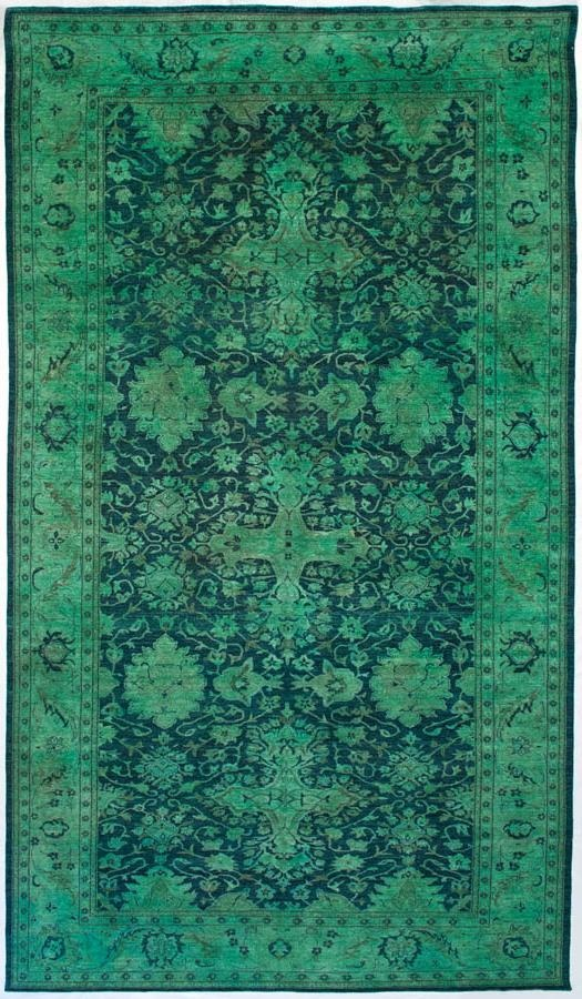 Described as a nearly 9x18 area rug, this traditional oriental pattern features the un-traditional colors of emerald and teal.