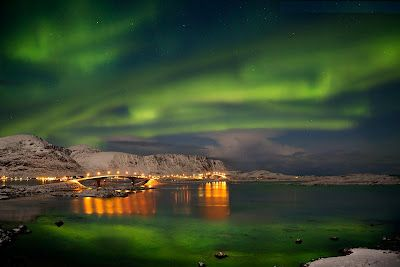 2. Alaska- Take a dogsled around the North Pole to see the glaciers, reindeers, and penguins, Stay in a cozy cabin/cottage near Fairbanks, & look at the Northern Lights. :D