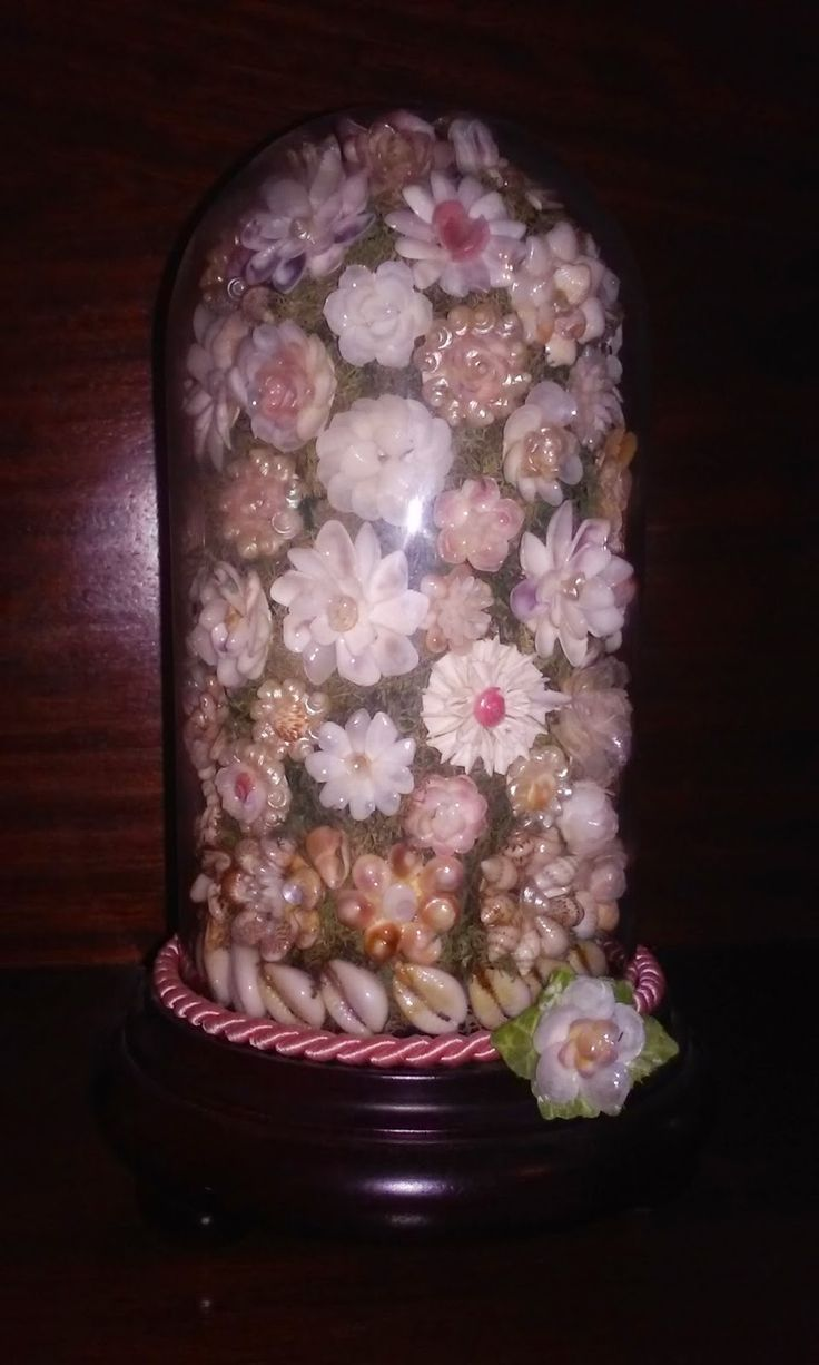 Decoraci n con conchas de mar ramo de flores hechas con - Decoracion con conchas ...