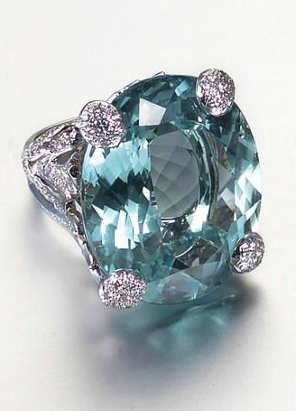 An aquamarine and diamond dress ring, by Dior The large oval-cut aquamarine within an openwork foliate mount pavé-set with brilliant-cut diamonds, aquamarine approx 54.00 carats, diamonds approx 2.00 carats total, signed Dior, numbered, French assay marks, fitted case by Dior