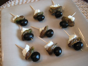 Smoked Oyster Canapés…very good JUST tried these! Smoked oyster, pitted black olive, philly chive cream cheese. low carb snack