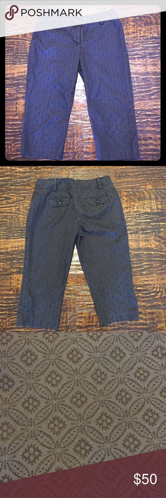 """Ann Taylor Petite Margo Jacquard Capris Great jacquard pattern in very dark grey background with subtle black circle designs. Darts on back side for a more flattering fit. Back pockets with fabric covered buttons. Gently worn. Good condition. 58% Cotton, 39% Polyester, 3% Spandex.   Approximate Measurements (unstretched):  Waist - 30"""" Lower hips - 37"""" Rise - 9.25"""" Inseam- 18"""" Ann Taylor Pants Capris"""