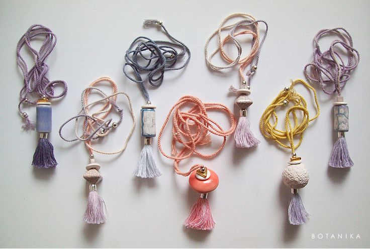 necklaces featuring naturally dyed cotton cord and tassles with hadmade ceramic beads