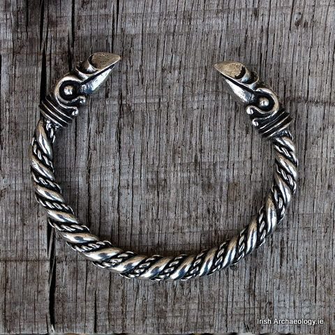 Viking bracelet raven. The body of this chunky Viking bracelet is decorated with twisted coils, while the terminals are surmounted by stylised raven's heads.  The raven's heads are inspired by Norse mythology, where the god Odin was associated with a pair of ravens called Huginn and Muninn. Available here http://irisharchaeologyshop.com/collections/viking-bracelets/products/viking-raven-bracelet