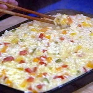 Ingredients 1 tablespoon saffron threads2 tablespoons warm water4 1/2 to 5 cups homemade chicken broth6 tablespoons butter1/2 cup finely minced white onion2 cups Arborio rice1 cup dry white wine3/4 cup grated Parmigiano-Reggiano cheese Martin Yan's Veggies 1/2 Green Pepper, diced1/2 Yellow Pepper, diced1/2 Red Pepper, diced1/2 small zucchini, diced2 tbs minced ginger1 Jalapeno pepper, chopped, with seeds and membrane removed
