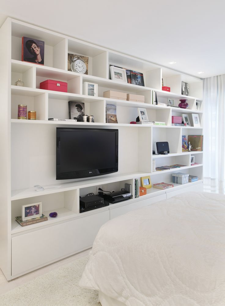 Multi size shelves wall unit entertainment center for Bedroom entertainment center