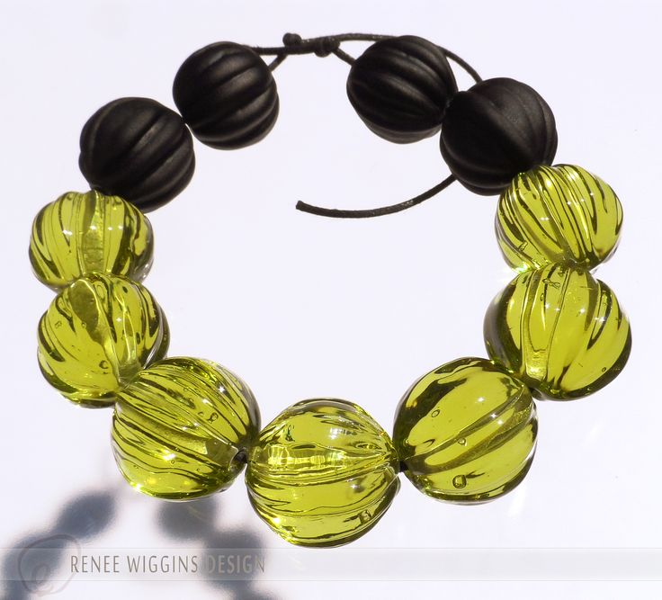 """These are some new lampworked beads I made with a rustic press I have. They're not quite """"melon"""", but more like a seed pod or walnut shape. Simple color & texture, not like my """"fancy"""" stuff. :) I see a tribal inspired necklace in its future! RWD 2015"""