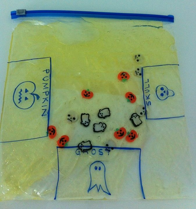 """love the idea of using a sensory bag to work on fine motor skills. Sort the pumpkins, skulls, and ghosts into the right """"goals"""""""
