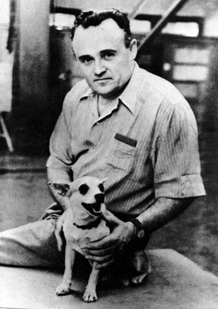 Soviet rocket-scientist Sergei Korolev and the dog Laika, the first living creature to be sent into outer space. Laika was placed in the nose-cone of the R-7 rocket and died six hours after being launched into orbit.