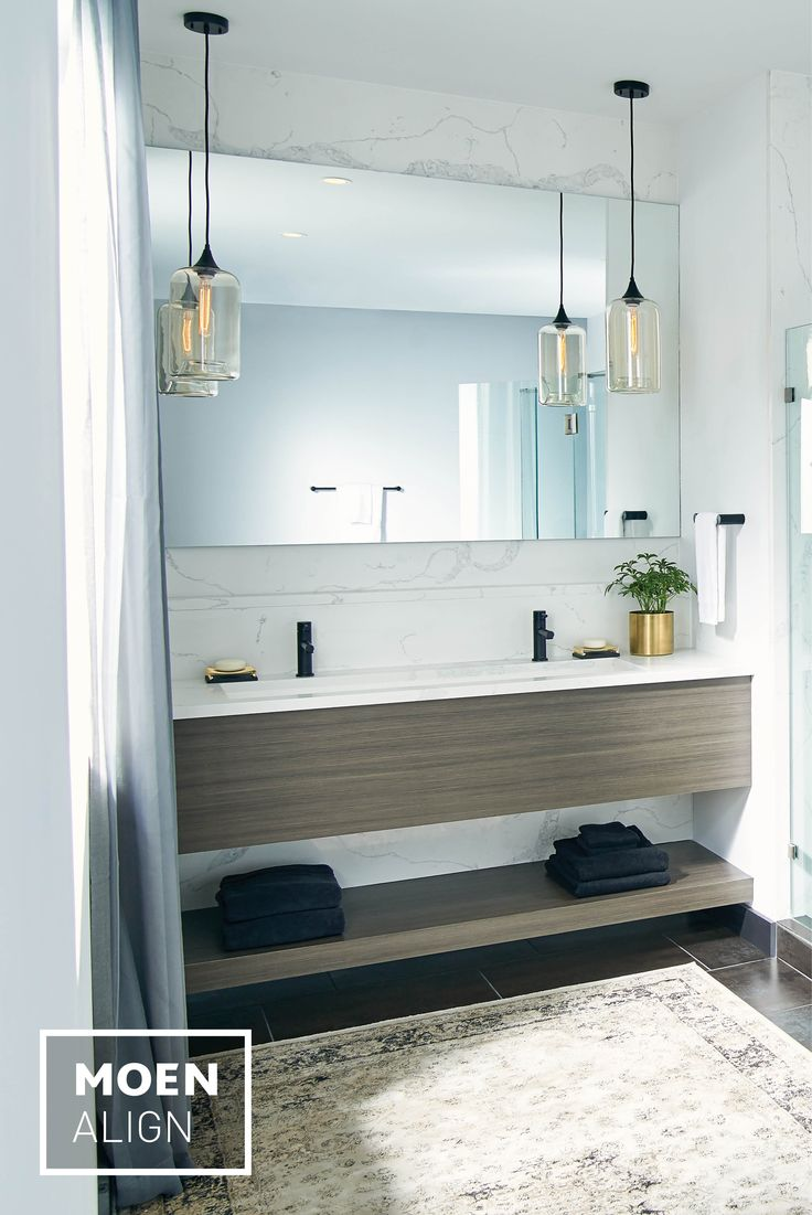 photos of remodeled bathrooms%0A Our Align matte black faucet provides a bold counterpoint to its simple  surroundings