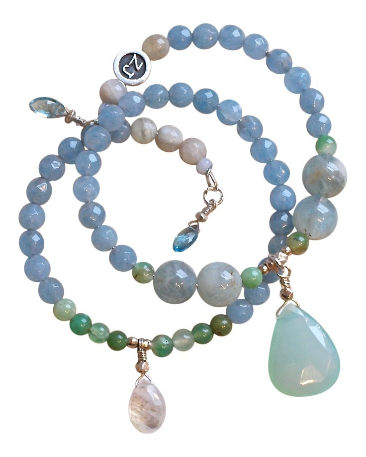This gorgeous wrap is a one of a kind. It is made of Angelite, Aquamarine, Moonstone, Chalcedony and Chrysoprase. Each end is finished off with Blue Topaz fringe for an added delicate touch.  The large center crystal is a pear shaped Chalcedony drop (14.25 ct. weight) The pear shaped Moonstone drop is 3.25 ct weight The Blue Topaz fringe is 1.90 ct weight