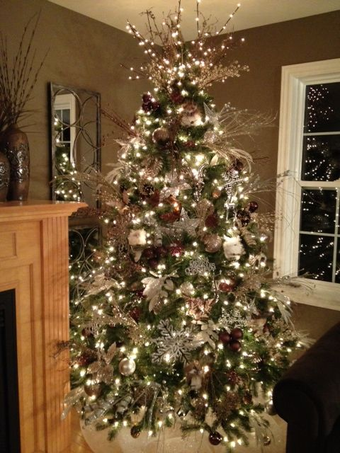 silver, brown & champagne christmas tree  I do this but I throw a pop or turquoise and red