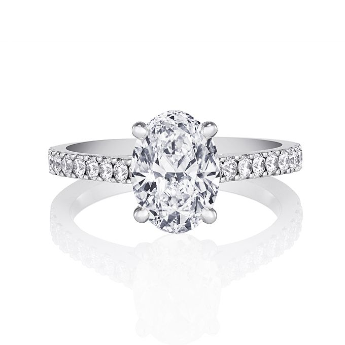 Brides.com: Oval-Cut Engagement Rings. Classic pavé engagement ring, four-prong-set oval-cut engagement ring and round brilliant pavé diamonds in platinum, price upon request, De Beers  See more De Beers engagement rings.